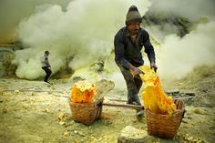Miners collecting sulphur by the vent at Ijen Crater - Kawah Ijen, East Java, Indonesia