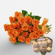 12 Orange Roses Bouquet and 16 pcs ferrero chocolate.