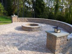 Stone Patio With Rounded, Continuous Ledge (bench) U0026 Fire Pit
