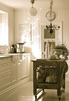 Beautiful Swedish Kitchen.  Wood counters, farm sink, rolling island, tongue and groove wooden walls.