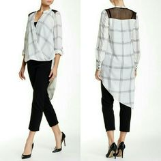 """Hi Lo Windowpane Blouse Blotted lines form the pane plaid print of an asymmetric hi-lo top while a mesh yoke contrasts the crepe fabrication. This blouse includes removable/adjustable cami tank top!  - Surplice neck - Long sleeves with double barrel cuffs and roll tabs - Approx. 23"""" shortest length, 43"""" longest length - Approx. 25"""" cami length - Imported Fiber Content: Self: 100% polyester Contrast: 100% cotton Cami: 96% rayon, 4% spandex Tops Blouses"""