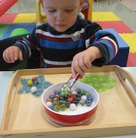 Marbles or pom poms onto suction cups with tongs