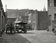 """Produce wagon in city, 1923."""" One in a series of Harris & Ewing plates showing the alleys and backstreets of Washington, D.C. The subject here is a Chaconas grocery wagon."""