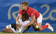 Fiji's Jasa Veremalua scores a try in the men's rugby sevens gold medal match between Fiji and Britain during the Rio 2016 Olympic Games at Deodoro Stadium in Rio de Janeiro on August 11, 2016.
