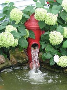Fire hydrant fountain I created 10 years ago for my front pond.