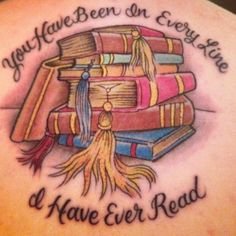"""My tattoo is a quote from Great Expectations by Charles Dickens. It reads """"You have been in every line I have ever read"""" and is accompanied by a stack of books. I fell in love with this quote as soon as I saw it and had to get it. For me it means that books can get you through life and love and it represents my love of reading and literature."""