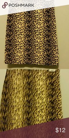 Leopard colored skirt size 7/8, 20 in. Long Color is not so good as picture Vintage blue Skirts Midi