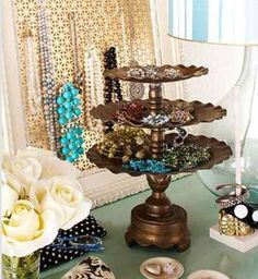 Jewelry display... like this stand.  Looks like it is made from this silver trays and a chunky candlestick holder.  Easy to make!