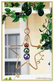 wire and marble suncatcher... maybe a big flower shape with yellow marbles?