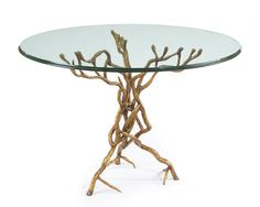 "30""Hx44""D The glass top is supported by a metal sculpted base in the form of twisted branches. The finish is old gold."