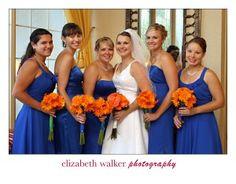 Orange bouquets with blue bridesmaid dresses