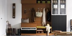 Entryway Idea: Love the bench with upper storage and contained storage idea. Less clutter to show/create.