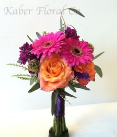 Bridesmaid Bouquet with Pink Gerbera Daisies, Orange Roses, Purple Stock, and Scabiosa Pods