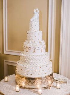 An ornate, five-tier white wedding cake | @rebeccayale | Brides.com