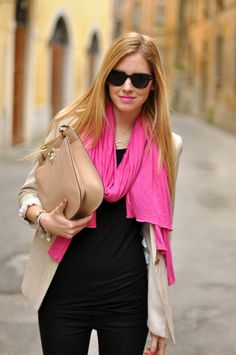 Black outfit, beige blazer and bag and hot pink scarf