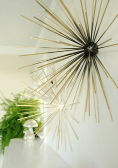 DIY wall sculpture made from bamboo skewers (which I have a ton leftover from another project...hello, this is happening!)