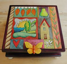 """Sticks creates this artistic one-of-a-kind Keepsake Box. Hand drawn whimsical designs are burnt in to the wood and then painted. * Size: 11""""L. x 11""""D. x 5""""H. * Signed, Dated Sticks furniture, lighting"""