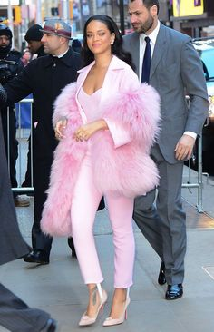 Rihanna displays her unique style in sickly sweet tonal outfit and over-sized furry scarf as she arrives for TV appearance in New York. I love this outfit its daring and stands out! Estilo Rihanna, Mode Rihanna, Rihanna Style, Pink Fashion, Star Fashion, Fashion Outfits, Womens Fashion, Rhianna Fashion, Fashion Clothes