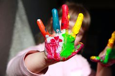 Cute little girl with painted hands - Photo