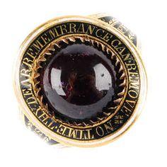 A George III garnet and enamel memorial ring.