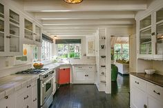 cute little kitchen - solution for low ceilings (beams, white paint, natural light)  via HookedonHouses