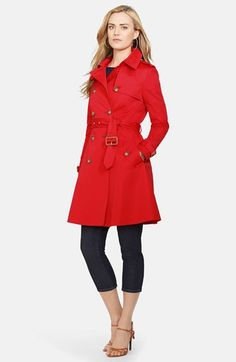 Free shipping and returns on Lauren Ralph Lauren Double Breasted Skirted Trench Coat at Nordstrom.com. A spring trench in a flattering fit-and-flare silhouette exudes heritage style with faux-horn buttons and covered buckles, as well as an adjustable collar belt, button-down gunflaps and scalloped storm flap in back. An equestrian-motif  print inside adds a signature Ralph Lauren touch.