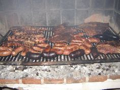 Asado: meat, sausage, and offal all on an outdoor grill.