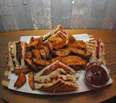 Extra Club Sandwich.  Biger bread, chicken,  bacon, tomato, cheese, ham.