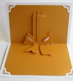 Christmas Candels Pop Up Greeting Card Home Décor 3D Handmade Cut by Hand Origamic Architecture in Festive Golden Yellow and White.