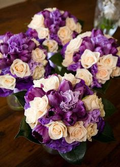 White roses, purple tulips, purple carnations