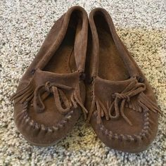 Minnetonka moccasins Chocolate brown moccasins from Minnetonka. SO comfy. Worn but they are so well made that they have yeeeears left of life left. Size 8 Minnetonka Shoes Moccasins