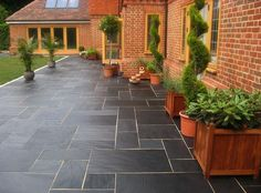 Black slate patio paving at a country home in England