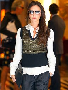 A smartly dressed Victoria Beckham, the newest goodwill ambassador for the UNAIDS program, struts her stylish stuff as she leaves a New York City hotel for business meetings on Friday.