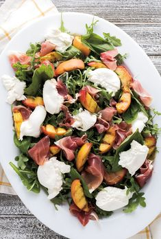 Sweet grilled peaches with creamy burrata cheese, prosciutto and basil over a bed of arugula make the perfect summer salad. Sweet grilled peaches with creamy burrata cheese, prosciutto and basil over a bed of arugula make the perfect summer salad. Grilled Peach Salad, Grilled Peaches, Grilled Ham, Grilled Zucchini, Clean Eating Snacks, Healthy Eating, Healthy Salads, Healthy Summer Recipes, Summer Salad Recipes