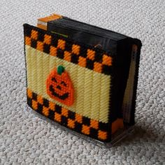 "Plastic Canvas: Three Little Pumpkins Napkin Holder Covers -- ""Ready, Set, Sew!"" by Evie (Etsy), $7.50"