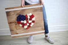 Stars and Stripes and pallet wood signs - this Fourth of July piece was made to bring celebrations into your home.  Shop now - link in our bio!