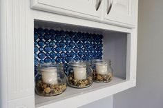 Don't let your budget limit your decorating options! Over at Small Home Soul, Toni used dollar store materials on a small budget to create an eye-catching backsplash. Find out what she did: [Dollar Store Glass Backsplash] Tags: backsplash, glass marbles Dollar Store Crafts, Dollar Stores, Iron Orchid Designs, Boho Home, Küchen Design, Design Ideas, Glass Containers, Do It Yourself Home, Old Wood