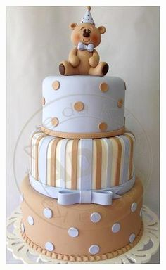 Baby Blue & Light Brown Stripes, Color Switch Polka Dots on Cake and Adorable Teddy Bear Topper. Looks like an adorable baby shower cake. Baby Cakes, Cupcake Cakes, Gateau Baby Shower, Baby Shower Cakes, Teddy Bear Cakes, Teddy Bear Baby Shower, Novelty Cakes, Gorgeous Cakes, Amazing Cakes