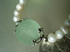 Freshwater pearl necklace made with and English sea glass marble. Great for wedding or elegant wear!