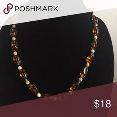 Interesting Bead Necklace No clasp or markings. I believe glass beads in tiger striped pattern. Very unique. 20 inches Jewelry Necklaces