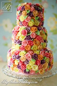 Cakes and Cupcakes multi-coloured wedding cake....wow this is gorgeous!  I'm sure it took lots of patience, skill and time,  kudos to whoever made this!