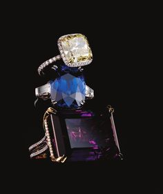 Harry Winston  Yellow diamond ring set in platinum and sapphire-diamond ring available at Harry Winston Salons