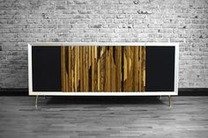 Mixing mid-century aesthetics with modern functionality, the Wren HiFi Model 1 Console is one of the most attractive vinyl setups you could put in your home. Based on the console stereos of years past, it incorporates a modified Pro-ject Debut...