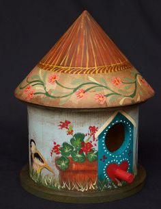 """hand painted and designed birdhouse that will decorate your home in so many ways and so many places. It measures 7"""" H x 5 1/2"""" W x 5 1/2"""" D."""