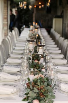 Long table with Eucalyptus leaves, roses and heaps of candles