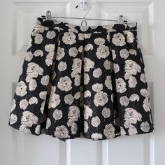 Forever 21 floral skirt Black and metallic gold. Preloved and used. Pleated skirt + floral design + back zip closure. Skirt is lined. no trades or paypal Forever 21 Skirts