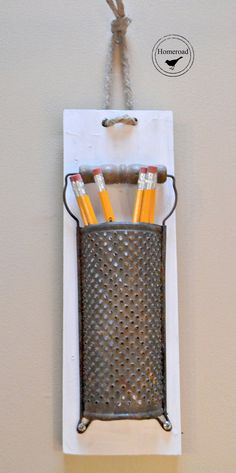 This adorable pencil holder is fashioned from a vintage grater. $ 20.00