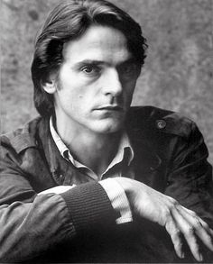 Jeremy Irons models the striped dress shirt and Members Only jacket.