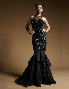 Zuhair Murad 2014 collections. Black long dresses with sheath neck, sequin at gown and mermaid skirt.