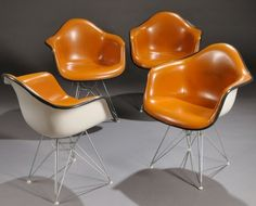 Party of Four - 1960s Eames for Herman Miller Shell Armchairs with orange naugahyde upholstery and zinc Eiffel base